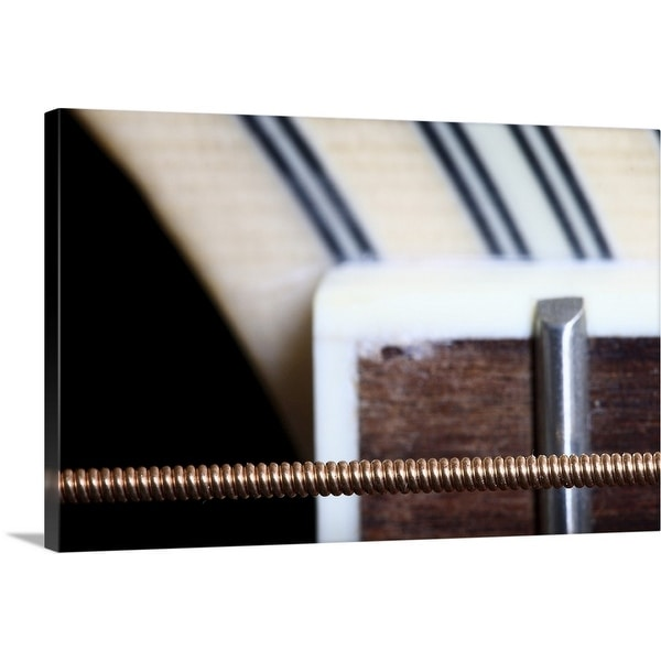 """""""Macro shot of sixth string of acoustic guitar showing part of fretboard."""" Canvas Wall Art"""