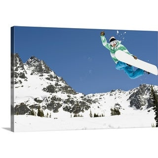 """""""male snowboarder jumping in air"""" Canvas Wall Art"""
