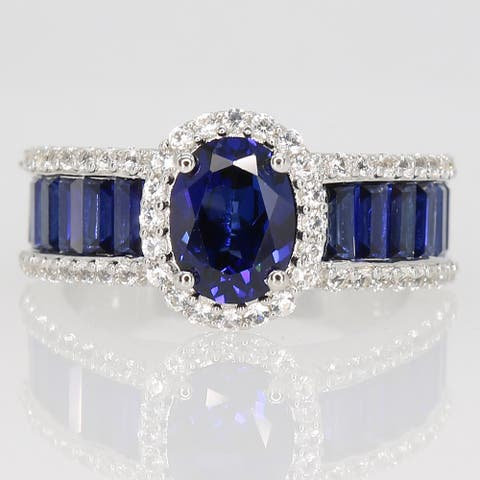 Oval & Baguette-cut Created Blue and White Sapphire Halo Engagement Ring in Sterling Silver by Miadora
