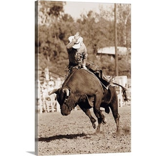 """Rider about to fall off bucking bull"" Canvas Wall Art"