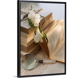 """""""Magnifying glass beside stack of books with flowers"""" Black Float Frame Canvas Art"""