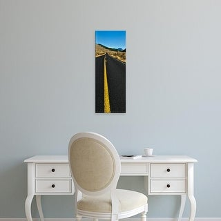 Easy Art Prints Panoramic Images's 'Road passing through a desert, Yellowstone National Park, Wyoming, USA' Canvas Art