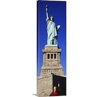 Premium Thick-Wrap Canvas entitled Low angle view of a tourist taking a picture of a statue, Statue of Liberty, Liberty