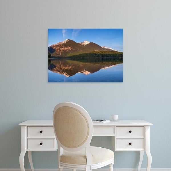Easy Art Prints Chuck Haney's 'Swan Mountains Reflect Into Calm Holland Lake' Premium Canvas Art