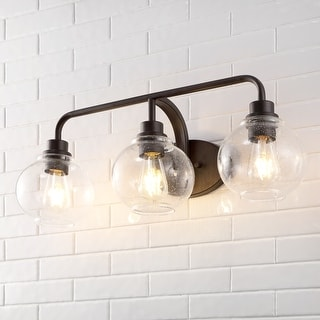 Link to Sandrine Iron/Seeded Glass Cottage Rustic LED Vanity Light by JONATHAN  Y Similar Items in Sconces