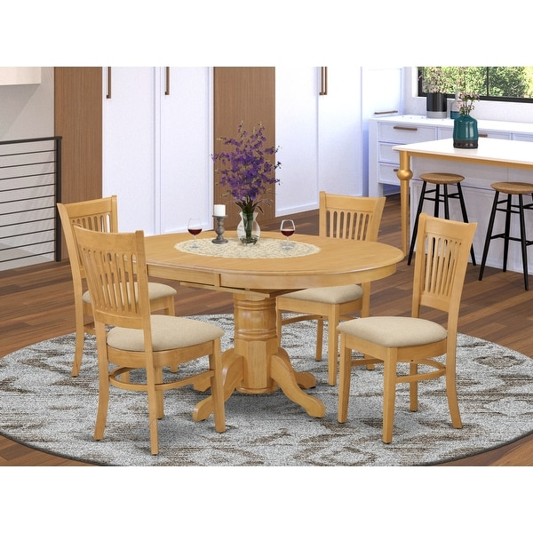 5-piece Dining Set Includes Oval Table and 4 Chairs In Oak Finish. Opens flyout.
