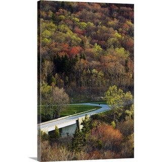 """High angle view of Blue Ridge Parkway winding through trees, spring, North Carolina"" Canvas Wall Art"