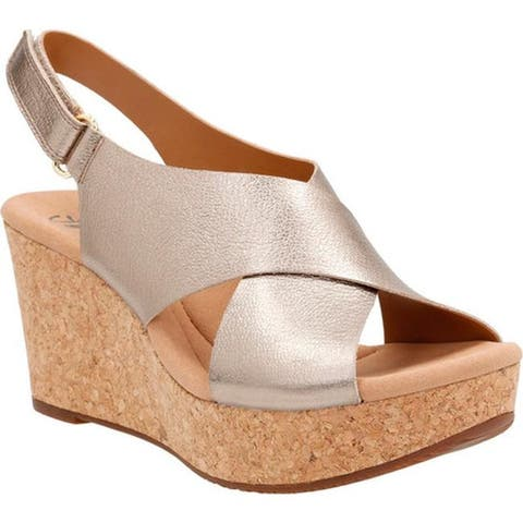 3000ba2515a Clarks Women s Annadel Eirwyn Slingback Wedge Sandal Gold Metallic Leather