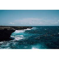 Cliff And Ocean Water Photograph Art Print