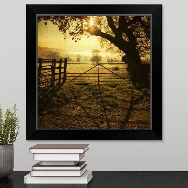 """Fence at sunset, reflection of fence on soil."" Black Framed Print"