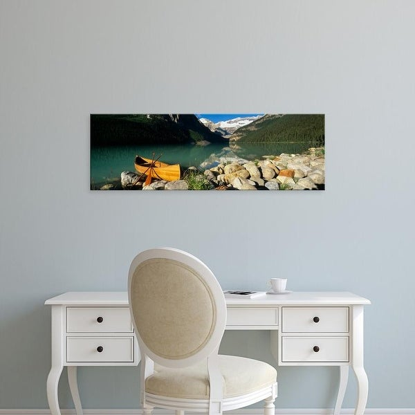 Easy Art Prints Panoramic Image 'Canoe at the lakeside, Lake Louise, Banff National Park, Alberta, Canada' Canvas Art