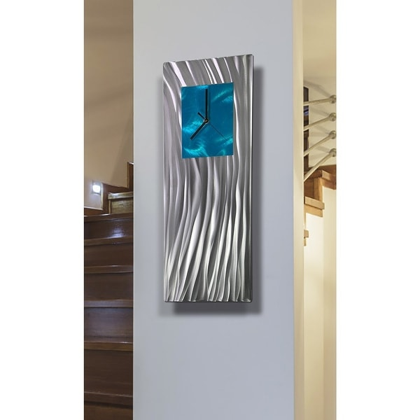 "Statements2000 Metal Wall Clock Art Modern Aqua Silver Accent Decor by Jon Allen - Ocean Energy - 24"" x 9"". Opens flyout."