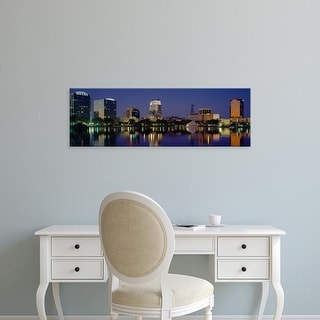Easy Art Prints Panoramic Images's 'Reflection of buildings in water, Orlando, Florida, USA' Premium Canvas Art