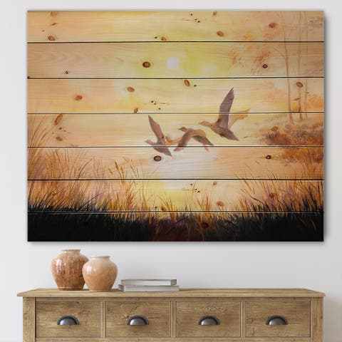Designart 'Three Cranes Flying Through Sunset' Traditional Print on Natural Pine Wood
