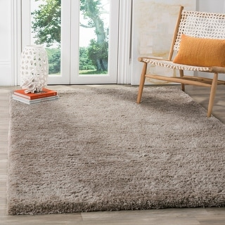 Link to Safavieh Handmade Sheep Shag Emmeline Solid Polyester Rug Similar Items in Shag Rugs