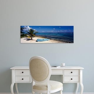 Easy Art Prints Panoramic Images's 'Rowboat on the beach, Grand Cayman, Cayman Islands' Premium Canvas Art