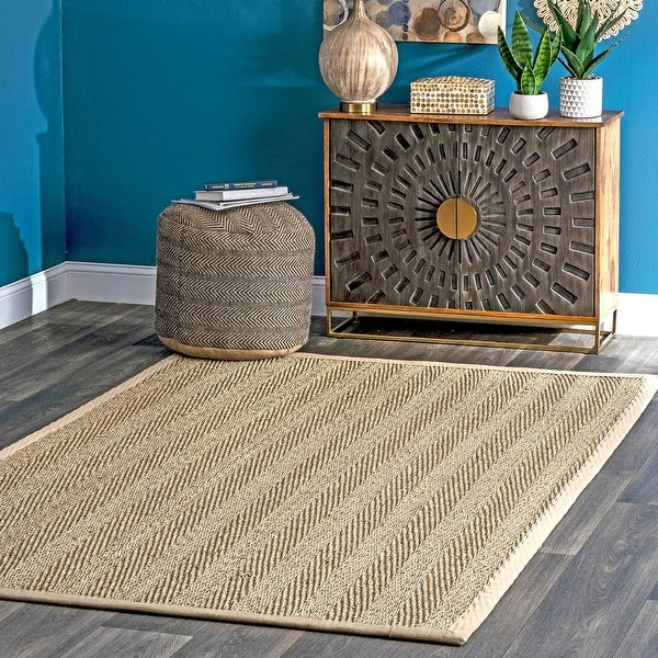 The Curated Nomad Vidua Seagrass Fiber Chevron Area Rug. Opens flyout.