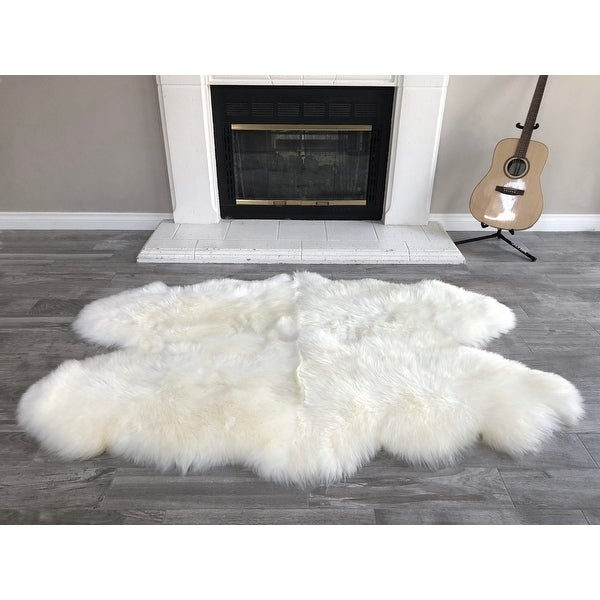"Dynasty Natural 4-Pelt Luxury Long Wool Sheepskin Shag Rug - 3'6"" x 5'6"". Opens flyout."
