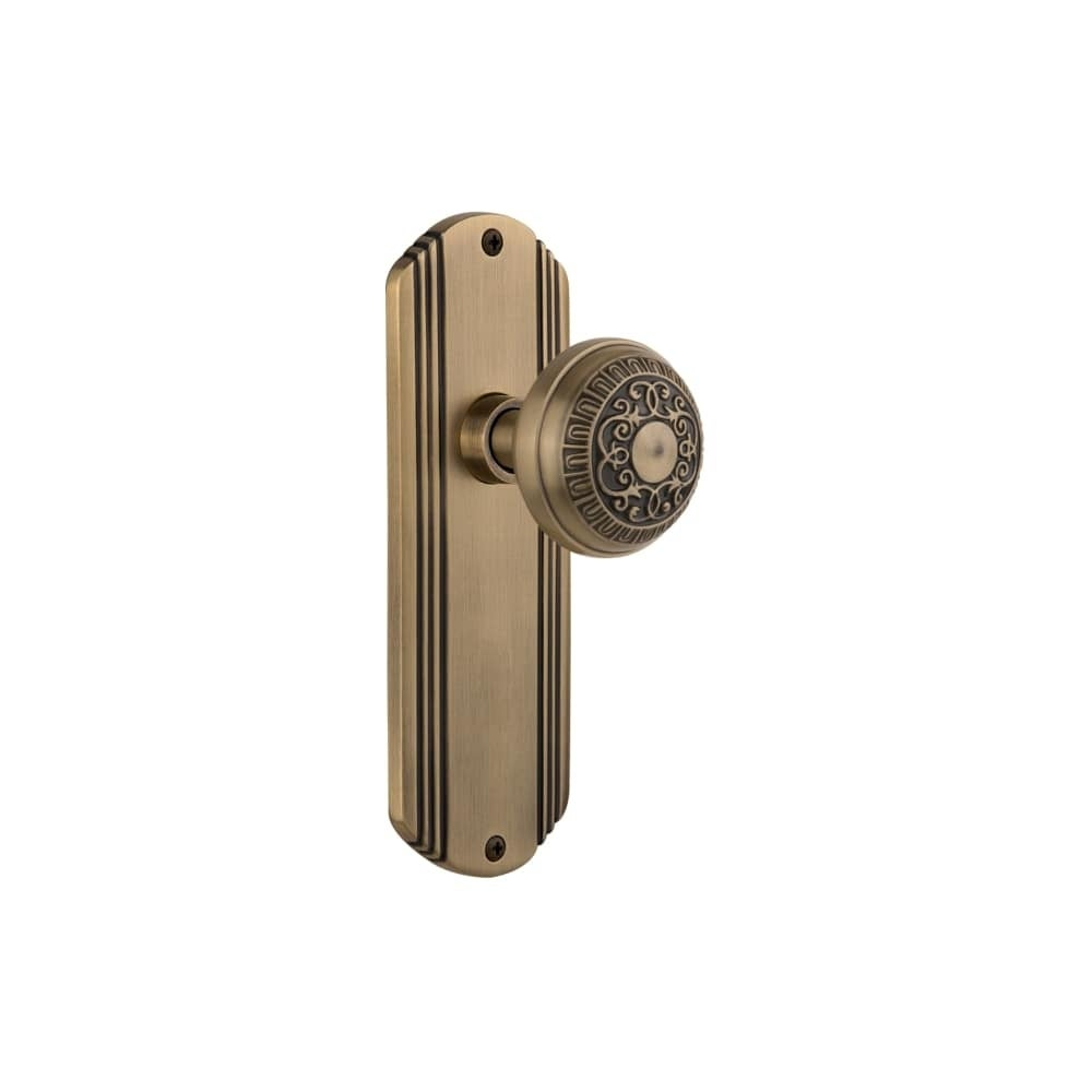 Nostalgic Warehouse DECEAD_PSG_238_NK  Egg and Dart Solid Brass Passage Knob Set with Deco Rose and 2-3/8 Backset (Antique Brass)
