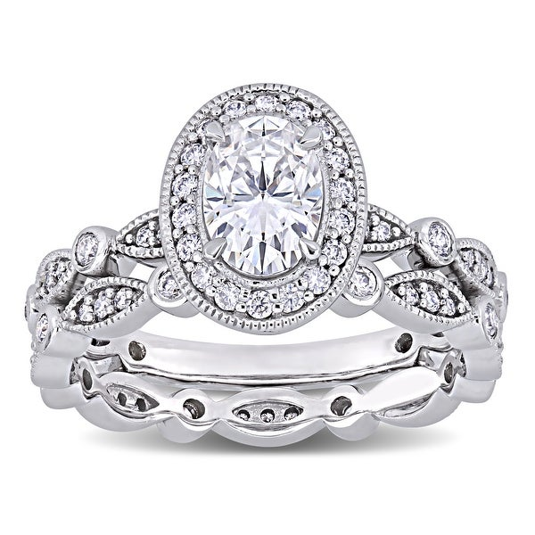 Miadora 1 1/2ct DEW Oval-cut Moissanite Halo Vintage Bridal Ring Set in 10k White Gold. Opens flyout.