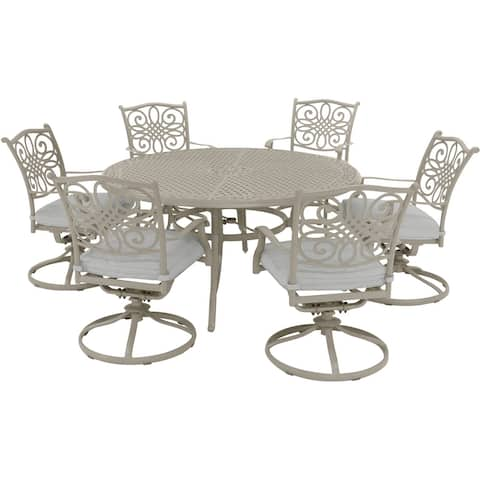 Hanover Traditions 7-Piece Dining Set with 6 Swivel Rockers and 60-in. Round Cast-top Table in Sand Finish