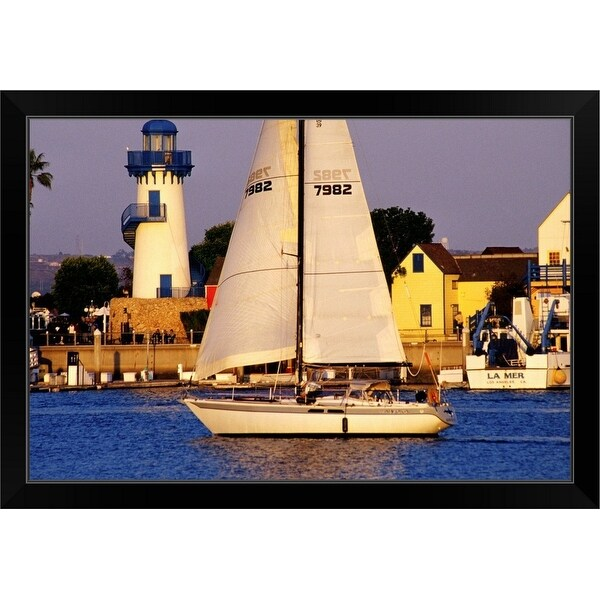 """Yacht sailing past lighthouse at Fishermen's Village, Marina del Rey"" Black Framed Print"