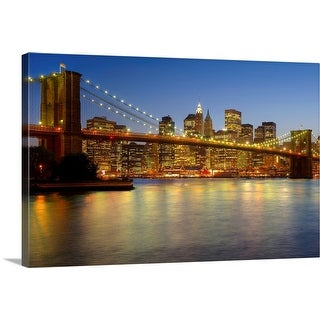 """Brooklyn Bridge and New York City buildings at night"" Canvas Wall Art"