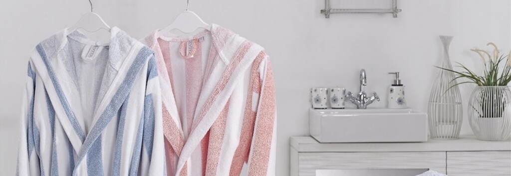 Blue and pink striped bathrobes next to each other