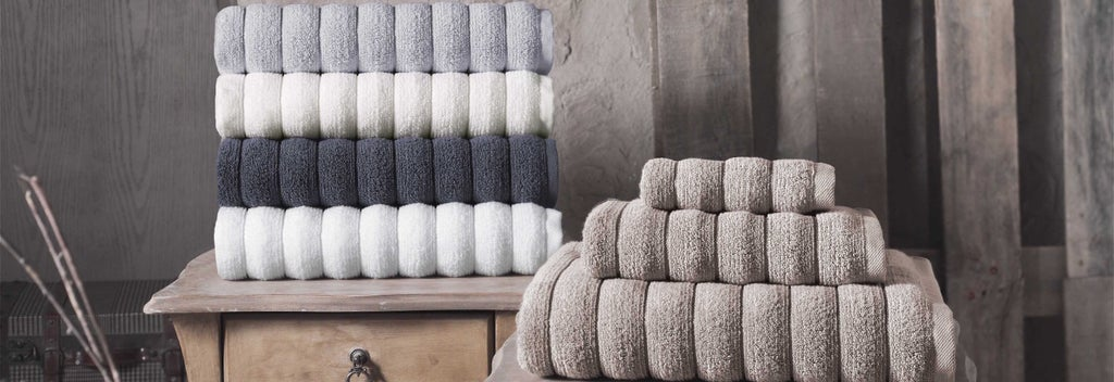 Stacked neutral colored bath towels