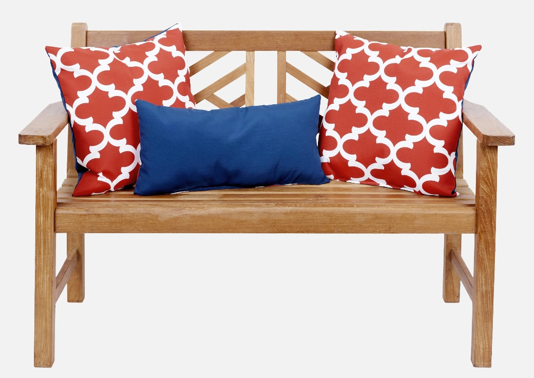 outdoor bench with red white and blue pillows