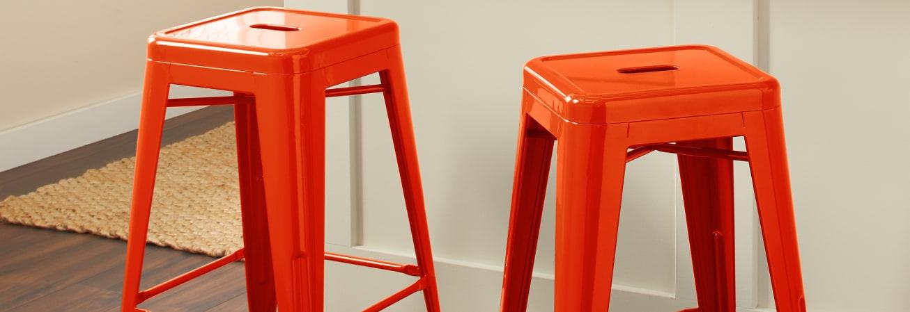 Orange metal bar stools.