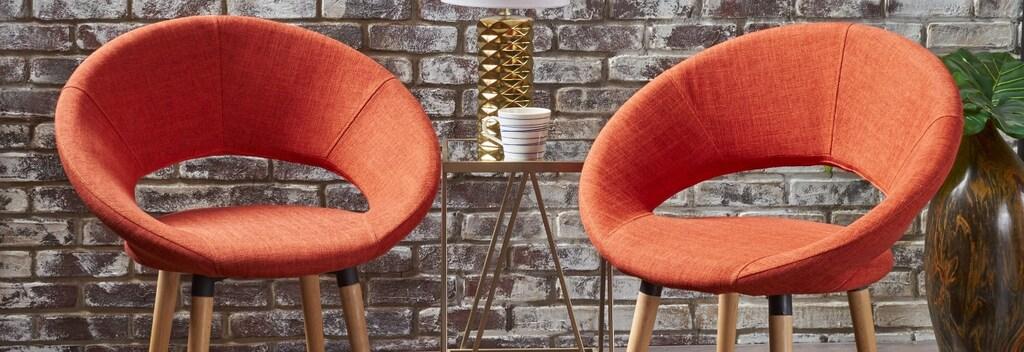 Orange mid century modern living room accent chairs.