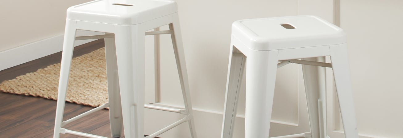 White metal bar stools.