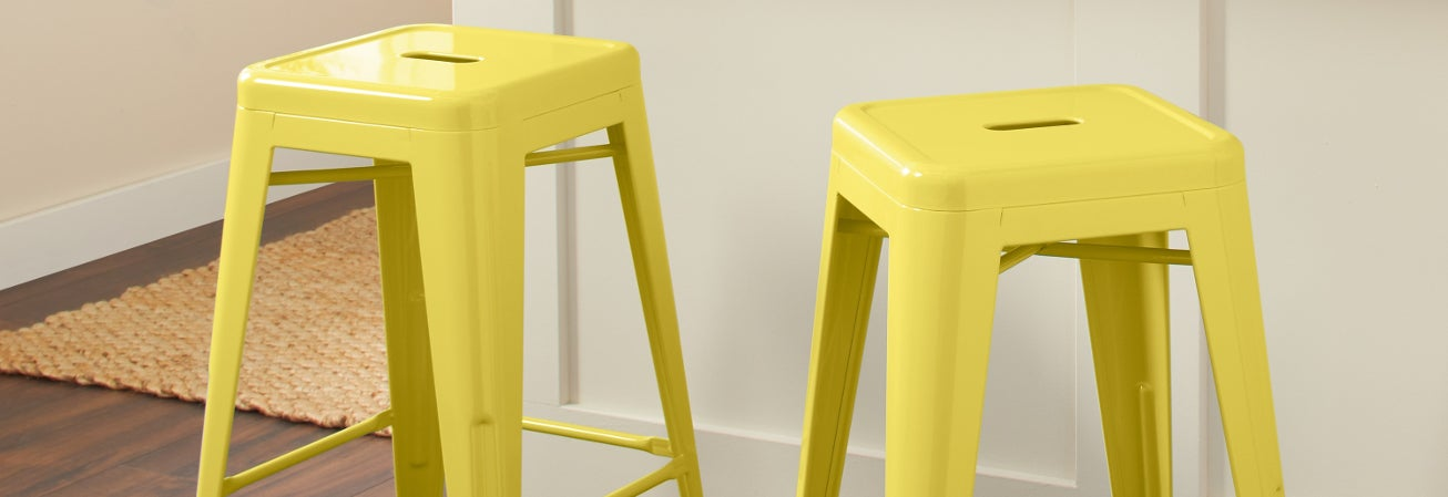 Yellow metal bar stools.