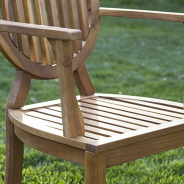 Close up image of outdoor teak patio chair