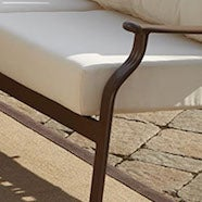 A montage of four images representing the four main types of outdoor furniture materials: metal, wood, wicker, and synthetics