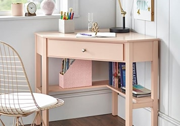 Corner desk with drawer and under-desk shelf storage