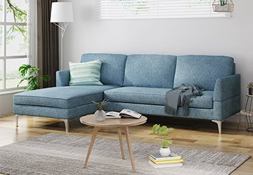 Blue sectional sofa in a small living room