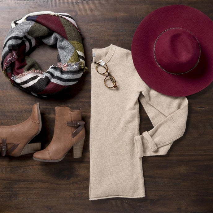 A showcase of women's fall attire with a beige sweater, scarf, booties, and a fedora available online at Overstock
