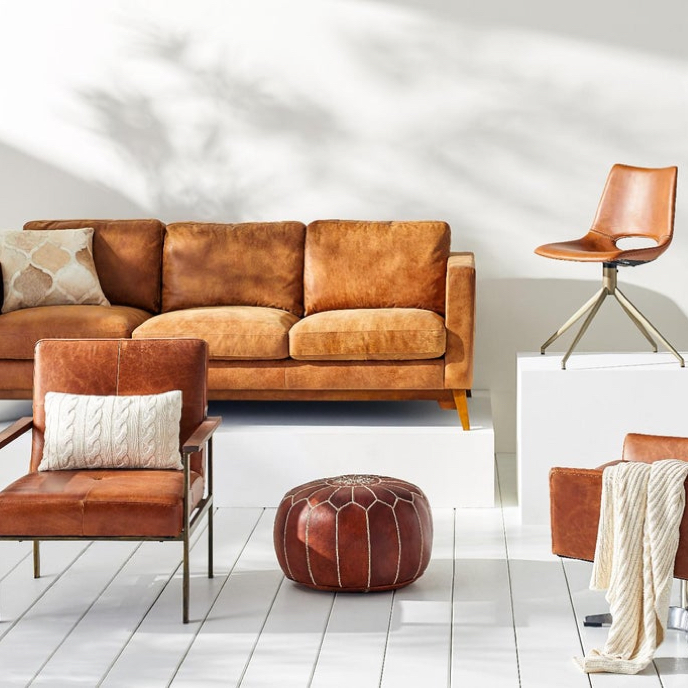A showcase of fall living room furniture made from light brown leather available online at Overstock