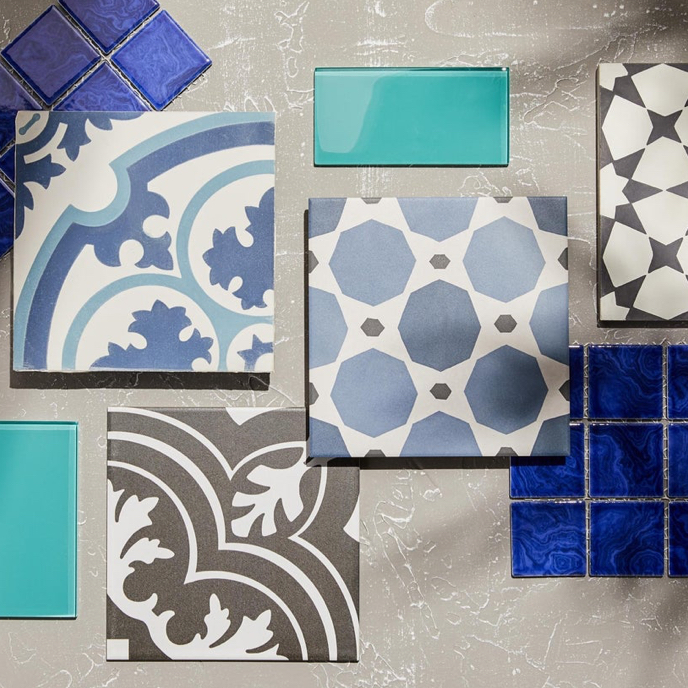 A showcase of moroccan tiles with varying shades of blue, white, and grey patterns available online at Overstock