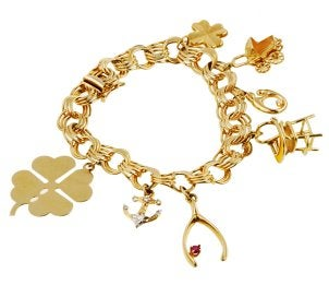 Gold charm bracelet with good luck charms