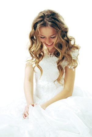 A beautiful modern bride looking down at her wedding band