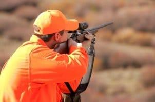 Man using hunting optics to spot a kill