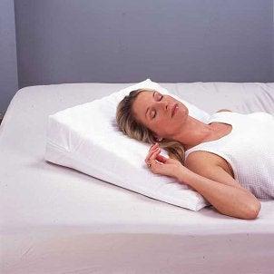 Woman sleeping on a memory foam wedge pillow