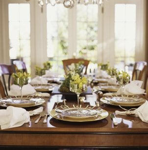 An elegantly set dining table welcomes guests
