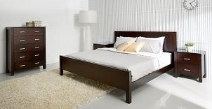 Bed with matching dressers and bedside table