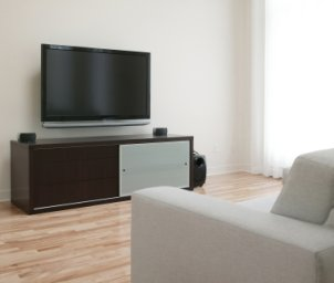 Large widescreen HDTV across from a couch
