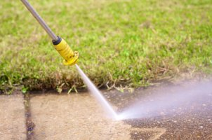 A power washer makes quick work of dirt