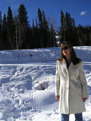 Woman in white, wool coat